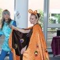 Wie kommt der Schmetterling Aponi zurück aus der Welt des Musicals